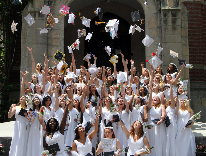 Notre Dame Academy graduation. Graduates throw caps in the air for group photo. (SUN/Julia Malakie)