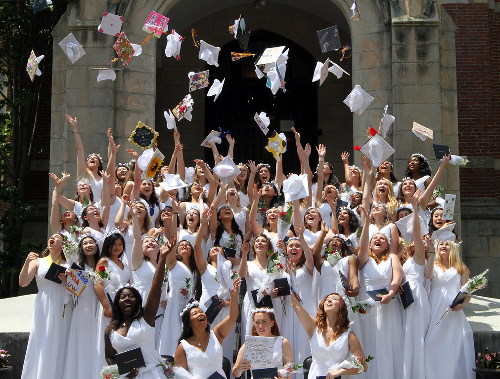 . Notre Dame Academy graduation. Graduates throw caps in the air for group photo. (SUN/Julia Malakie)