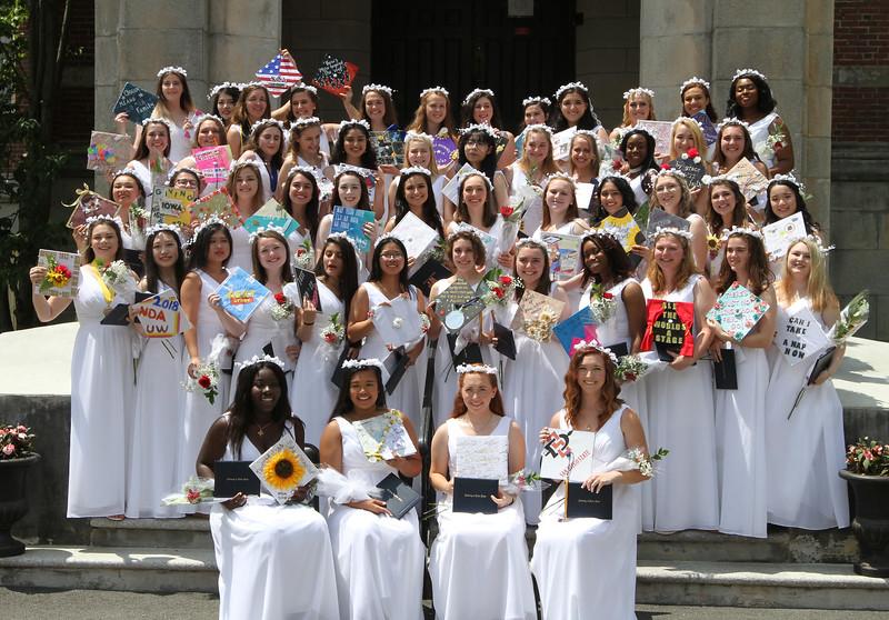 Notre Dame Academy graduation. Graduates assemble on steps for group photo. (SUN/Julia Malakie)