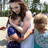 Notre Dame Academy  graduation. Graduate Claire French of Nashua and Groton hugs her cousin Caroline Murphy, 8, of Dedham. At right is their cousin Julianna Kay, 8, of Uxbridge. (SUN/Julia Malakie)