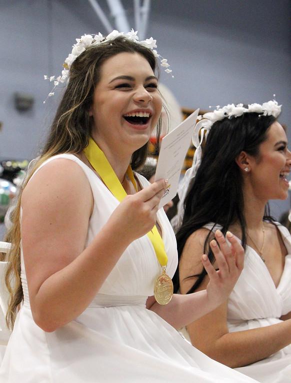 . Notre Dame Academy graduation. Sarah Piela of Nashua fans herself with program at humid ceremony. (SUN/Julia Malakie)