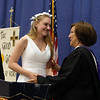 Notre Dame Academy  graduation. Kathryn Tarantino of Pepperell receives the Saint Julie Medal from principal Helen Kay. (SUN/Julia Malakie)