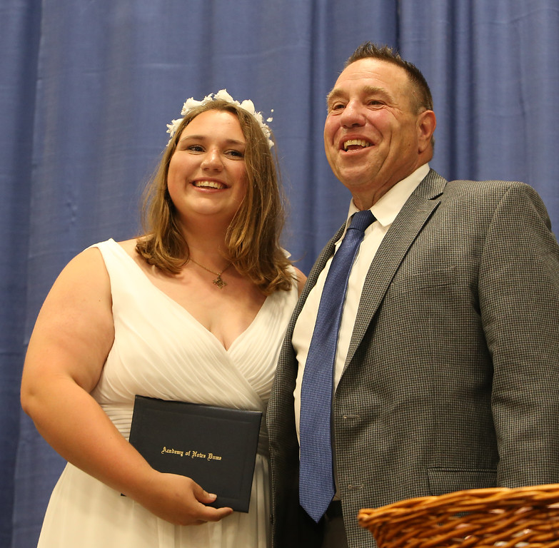 . Notre Dame Academy graduation. Katelyn Scarano of Tewksbury receives diploma from her father Robert Scarano, a former board member. (SUN/Julia Malakie)