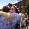 Notre Dame Academy graduation. Alexia Landry of Dracut hugs her aunt, Maryelllen Moll, NDA '73, of Salem, N.H. (SUN/Julia Malakie)