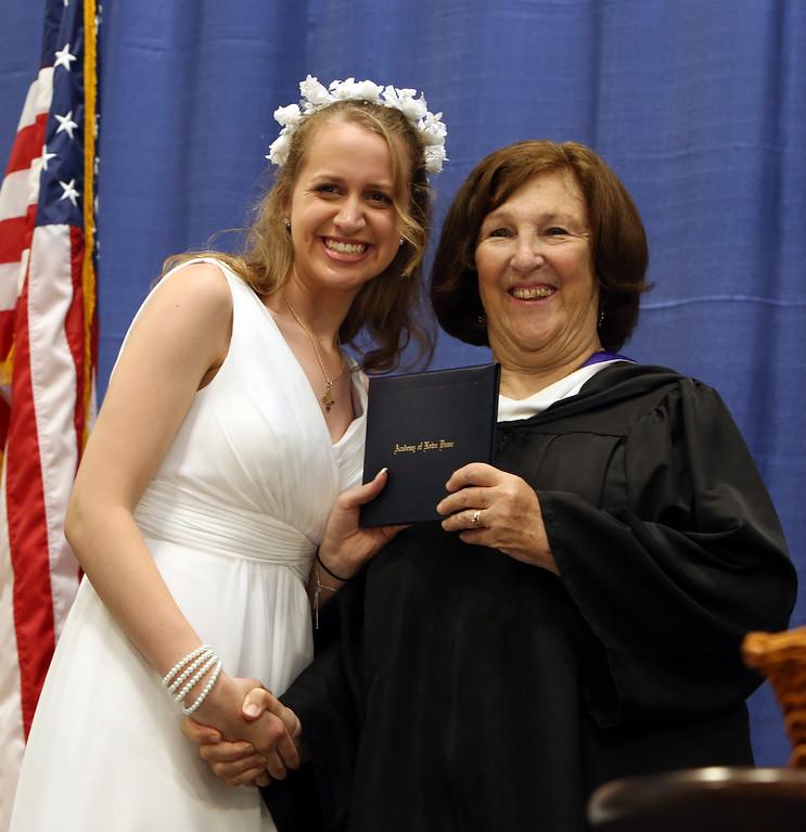 . Notre Dame Academy graduation. Cara Fischetti of Groton with president Helen Kay. (SUN/Julia Malakie)