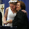 Notre Dame Academy graduation. Kathryn Tarantino of Pepperell receives Sister Julie medal from principla Helen Kay. (SUN/Julia Malakie)