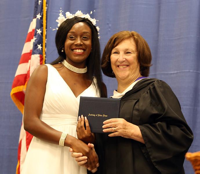 Notre Dame Academy  graduation. Everilde Sam of Dracut with principal Helen Kay. (SUN/Julia Malakie)