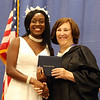 Notre Dame Academy  graduation. Everilde Sam of Dracut with principal Helen Kay. (SUN/Julia Malakie)