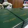 Record-Eagle/Keith King<br /> Northwestern Michigan College diploma binders lie on a table Saturday, May 7, 2011 prior to the start of the NMC commencement ceremony at Traverse City Central High School.