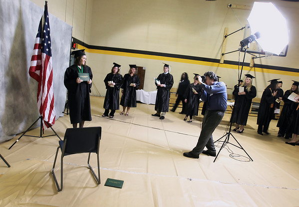 Record-Eagle/Keith King<br /> Nicole Rubritius, left, has her photo taken prior to the start of the  Northwestern Michigan College commencement ceremony Saturday, May 7, 2011 at Traverse City Central High School.