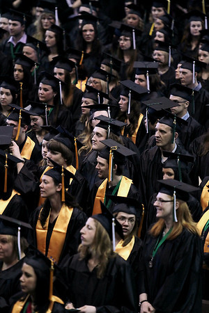 Record-Eagle/Keith King<br /> Students stand at the start of the Northwestern Michigan College commencement ceremony Saturday, May 7, 2011 at Traverse City Central High School.