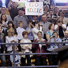 Record-Eagle/Keith King<br /> Signs of support are held high as students enter the Traverse City Central High School gymnasium Saturday, May 7, 2011 during the Northwestern Michigan College commencement ceremony.