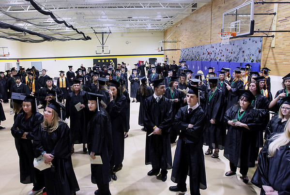 Record-Eagle/Keith King<br /> Students listen to instructions prior to the start of the Northwestern Michigan College commencement ceremony Saturday, May 7, 2011 at Traverse City Central High School.