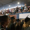 Record-Eagle/Douglas Tesner<br /> <br /> Almost graduates and their family and friends stream out of the building during NMC's graduation after a false fire alarm.