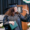 Record-Eagle/Douglas Tesner<br /> <br /> NMC graduate Shannon Smith waives to the crowd during Saturday's commencement ceremony at Traverse City Central High School.