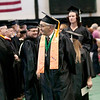 Record-Eagle/Douglas Tesner<br /> <br /> Luc Serriere, 69, walks during the processional at the NMC graduation at Traverse City Central High School.