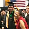 Record-Eagle/Douglas Tesner<br /> <br /> Cheryl Kukla congratulates her son John Kukla with a hug and smile as he walks into the NMC graduation at Traverse City Central High School.