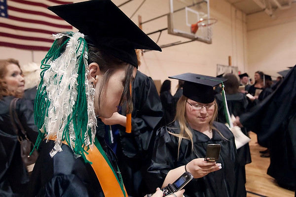 Record-Eagle/Douglas Tesner<br /> <br /> Jennifer Butler adorned her hair with green and white streamers to make up for not having a green and white tassel. Butler graduated from NMC with honors, so her tassel is gold.