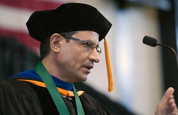 Record-Eagle/Douglas Tesner<br /> <br /> Amjad Khan, the 2009 Imogene Wise Faculty Excellence Award recipient, spoke Saturday during NMC's graduation at Traverse City Central High School.