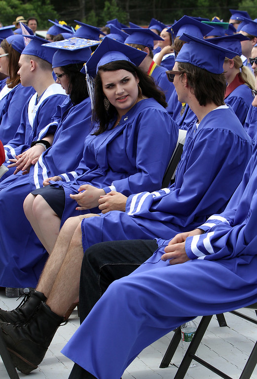 . Nashoba Tech graduation. Kameron Adams of Tewksbury, left, and Caleb Ackerman of Pepperell keeps their legs cool. Malakie)