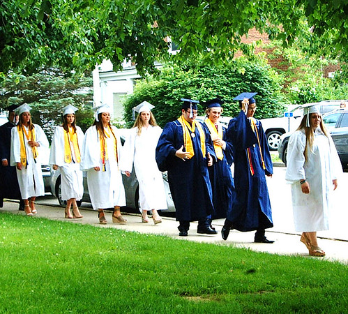Diane Raver | The Herald-Tribune<br /> Seniors make their way along the sidewalk to the chapel.