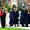Diane Raver | The Herald-Tribune<br /> Students line up outside the chapel.