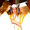 Diane Raver | The Herald-Tribune<br /> Classmates Katie Kinker (from left), Jaydann Simmonds and Abbigayl Eldridge prepare for the ceremony.