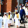 Diane Raver | The Herald-Tribune<br /> The new graduates process out of the chapel.