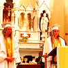 Diane Raver | The Herald-Tribune<br /> Lydia Gigrich (right) and Abbigayl Eldridge read the prayers of the faithful.
