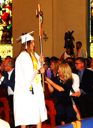 Diane Raver | The Herald-Tribune<br /> Alexandra Bamonte carries the cross into the chapel.