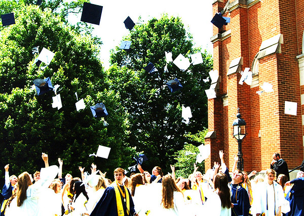 Diane Raver | The Herald-Tribune<br /> After the graduates exited the chapel, the caps flew in the air.