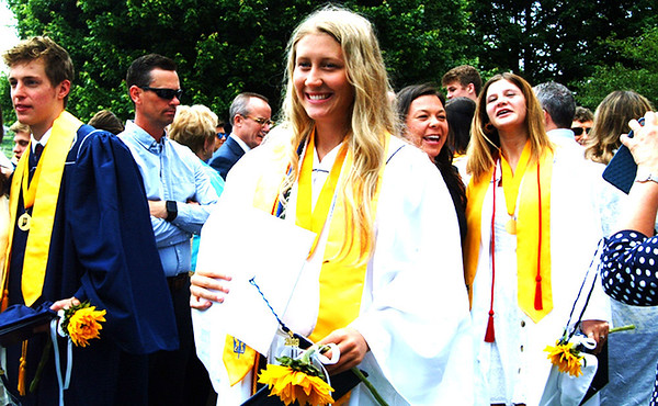 Diane Raver | The Herald-Tribune<br /> Graduates, including Hanna Hurm, pose for pictures afterwards.