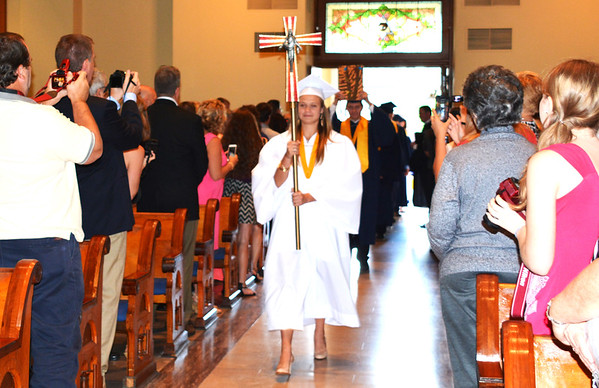 Diane Raver | The Herald-Tribune<br /> Cross bearer Taylor McGraw led her classmates into the chapel.
