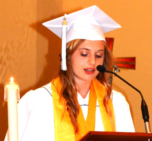 "Diane Raver | The Herald-Tribune<br /> Salutatorian Erica Geers said, ""Every single one of us has triumphantly completed 720 days, 17,280 hours, over 1 million minutes of long and exhausting and enduring homework, tests, papers and assignments all to get to this moment."""