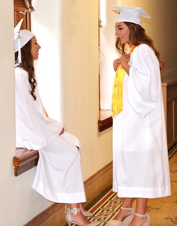 Diane Raver | The Herald-Tribune<br /> Audrey Oesterling (left) and Caroline Storms talk prior to graduation.