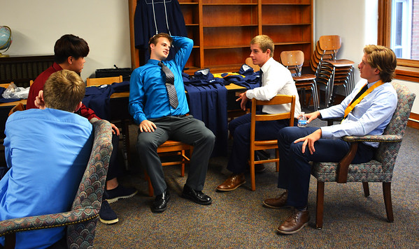 Diane Raver | The Herald-Tribune<br /> Students talk before putting on their graduation gowns for the ceremony.