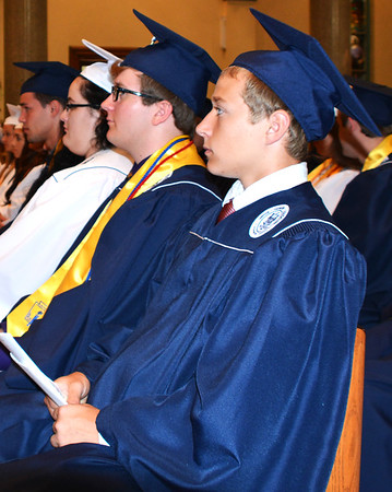 Diane Raver | The Herald-Tribune<br /> Students listen attentively during the Mass.