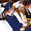 Diane Raver | The Herald-Tribune<br /> After receiving their diplomas and class flower, the sunflower, students watch their classmates come forward.