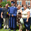 Diane Raver | The Herald-Tribune<br /> Graduates posed with family members following the ceremony.