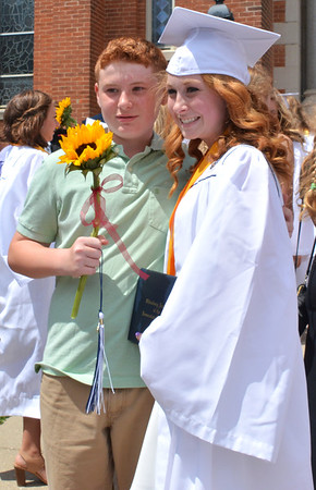Diane Raver | The Herald-Tribune<br /> Graduates smiled for photos after the Mass.