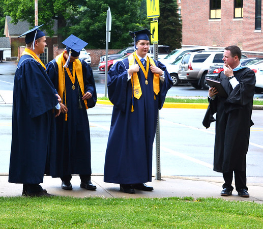 Diane Raver | The Herald-Tribune<br /> Teacher Jonathon Maple (right) waits with students outside the chapel.