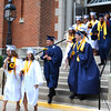 Diane Raver | The Herald-Tribune<br /> Graduates exit the chapel.