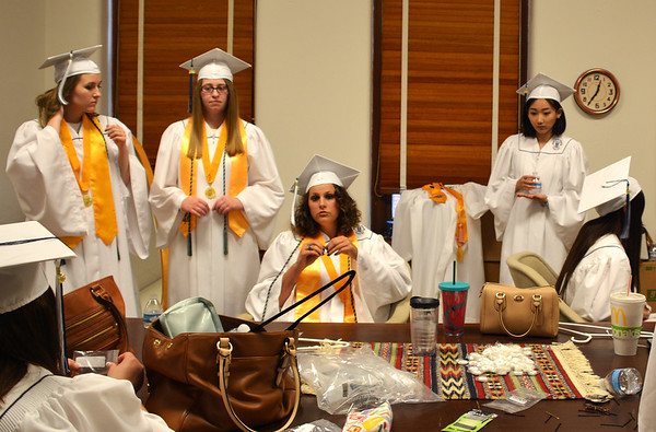 Diane Raver | The Herald-Tribune<br /> Students prepare for graduation.