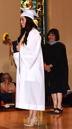 Diane Raver | The Herald-Tribune<br /> Maria Lewis is all smiles after receiving her diploma.