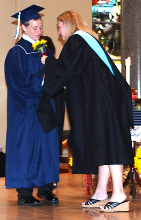 Diane Raver | The Herald-Tribune<br /> Aaron Huber receives a sunflower from guidance director Laura Geis.