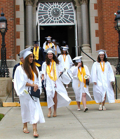 Diane Raver | The Herald-Tribune<br /> OA GRADUATES exit the chapel.