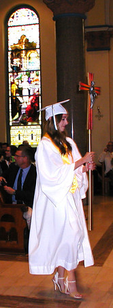 Diane Raver | The Herald-Tribune<br /> CROSS BEARER Meredith Maier walks up the aisle.