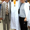 Diane Raver | The Herald-Tribune<br /> GRADUATES posed for pictures following the ceremony.