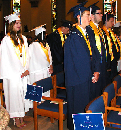 Diane Raver | The Herald-Tribune<br /> OA SENIORS stand as they wait for the rest of their classmates to enter the chapel.