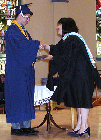 Diane Raver | The Herald-Tribune<br /> PRESIDENT Diane Laake congratuates a student as she hands him his diploma.